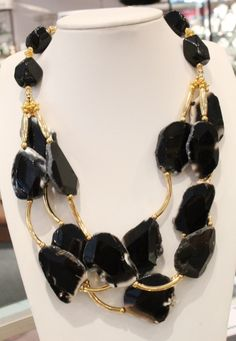 Triple strand necklace is black agate with obsidian and gold beads