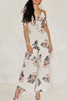 8c104b32ff3 Bohemian jumpsuit featuring floral printed, v-neck with ruffle trim, cold  shoulder design