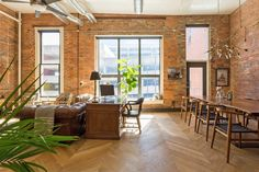 This 1800s downtown Nashville loft has high ceilings, big windows and brick walls to drool over.