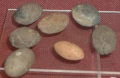 File:Sling bullets clay and stone.JPGSling bullets of baked clay and stone found at Ham Hill Iron Age hill fort.  Photograph was taken in the Somerset County Museum in Taunton on 29-Oct-05.