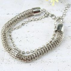Thick Silver Bracelet Thick Silver Bracelet with Rhinestone Accent, be bold with this unique bracelet that pairs with almost any outfit! One size fits most. Jewelry Bracelets