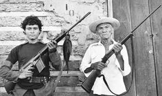 An 87-year-old veteran of the first Sandino rebellion stands with an 18-year-old Sandinista guerrilla in Leon, Nicaragua, June 19, 1979. Photograph: Richard Cross/AP    The Sandinista National Liberation Front overthrew Anastasio Somoza's dictatorship in July 1979 and established a socialist coalition government. The Somoza family had ruled Nicaragua from 1936 to 1979. Somoza allegedly embezzled funds sent to help rebuild the capital, Managua, after an earthquake in 1972. Shortly thereafter…