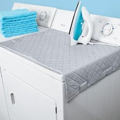 Magnetic Ironing Mat, turns your washer/dryer into an ironing board, then folds up after. Space saving item! $9.99 on Amazon. Brilliant!