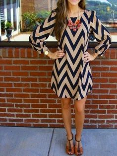 Chevron summer dress; and, a big necklace; I, absolutely, love, it; and, a bracelet--the color of the necklace--added, would complete the, 'look'! ('Rule of Design': repeatitive, color; in, sets of three; or, more; in, uneven numbers.