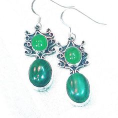Malachite and green jade team up here with an Asian flair in these pagoda earrings set in sterling silver. For matching malachite ring, click here: https://www.etsy.com/listing/187833053/ For matching malachite necklace, click here: https://www.etsy.com/listing/194177495/ For