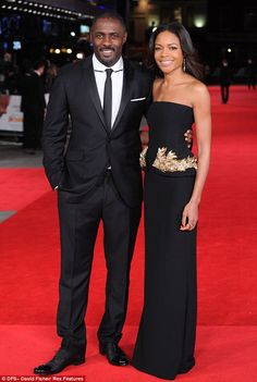 Unaware: Idris Elba and Naomie Harris posed at the premiere of 'Mandela : Long Walk To Freedom' on Thursday (December 5, 2013) evening unaware of the former president's death.