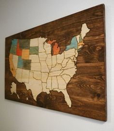 Very cool woodburned USA map. A great gift for anyone who loves travel and explore their country. The edging outside the map is stained while the states themselves arent. This allows for each state to be colored in as visited. A great way to track your vacations and exploration. home decor / USA wood sign / wood US map / track travel / custom decor