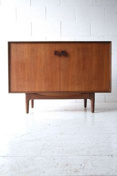 1960s Teak Sideboard by Kofod Larsen for G Plan 3 1960s Teak Sideboard by Kofod Larsen for G Plan £575 A 1960s teak sideboard by Kofod Larsen for G Plan. With teak veneer case and solid rosewood handles. In very good vintage condition with some age related wear and light marks. 102cm wide / 71cm high / 46cm deep next to sofa arm?