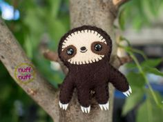 This little sloth is made with felt, embroidery yarn, 6mm safety eyes, polyfill stuffing, eva foam, and stuffed with a bit of lavender.