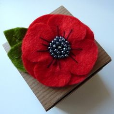 Poppy felt brooch flower brooch by CreatedWithLoveukItems similar to Handmade Poppy Brooch Felt Brooch on EtsyFelt flower layers can be put together in so many color and shape combinations! Perfect size for many of your DIY felt pBeautiful handcrafted bro Brooches Handmade, Handmade Felt, Handmade Flowers, Felt Flowers, Fabric Flowers, Paper Flowers, Fabric Brooch, Felt Brooch, Brooch Pin