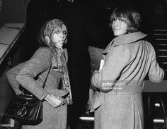 Rhythm guitarist Brian Jones (1942 - 1969) of the Rolling Stones group with his girlfriend Suki Potier at the premiere of a Swedish film, 'Candy', March 1969.