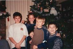 Spencer Phillips, Brittany, Brandon (peeking) Scott Phillips & Travis Tygart. Christmas 1998