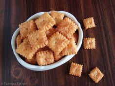 Homemade Cheez-Its Recipe     YIELD: 7 dozen crackers  Crisp cheddar copycat crackers    INGREDIENTS:  8 oz sharp cheddar cheese, grated  3 Tablespoons of unsalted butter, room temperature  1 Tablespoon vegetable shortening*  ½ teaspoon salt  1 cup flour  2 Tablespoons ice water  Coarse salt for sprinkling