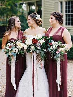 Rustic red and green wedding: Bridesmaids' Dresses: Jenny Yoo - http://www.stylemepretty.com/portfolio/jenny-yoo Wedding Dress: Mon Cherie - http://www.stylemepretty.com/portfolio/mon-cherie Floral Design: Virtu Floral and Event Design - http://www.stylemepretty.com/portfolio/virtu-floral   Read More on SMP: http://www.stylemepretty.com/2016/12/21/red-greenery-rustic-wedding/