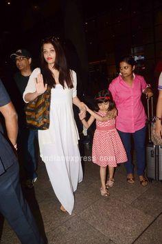 Aishwarya Rai Bachchan returning from Dubai with Aaradhya. Actress Aishwarya Rai, Aishwarya Rai Bachchan, Bollywood Actress Hot, Bollywood Celebrities, Hijab Fashion, Fashion Outfits, Bollywood Fashion, Manish Malhotra, Dress Codes