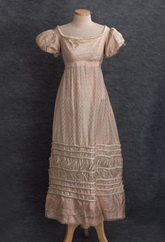 Vintage Textile: Young lady's satin damask dress, c.1825    The lovely dress was originally worn by a young lady from Salem, Massachusetts. It remained in her family until it recently came onto the market. Here is a refreshing simplicity and an endearingly feminine charm that will win all hearts.    The dress is fashioned from pale pink satin damask woven with a pretty pattern of small flowers and thistles. The neckline is outlined with a band of padded ivory satin.