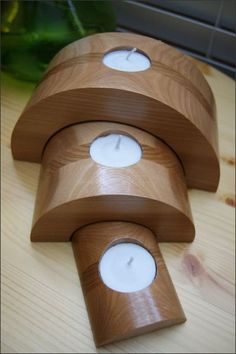 This candleholder set is simply beautiful. We laminated together Hickory and Cedar woods creating a solid block of wood. Then cut out each individual piece. Looking at the third picture you can see how we cut the individual pieces from the solid block of wood. Notice how the grains line up. Finally we added a recess for each tea light candle to fit into. It is then finished with a crystal clear gloss lacquer to show off the natural color and characteristics of the wood. $45