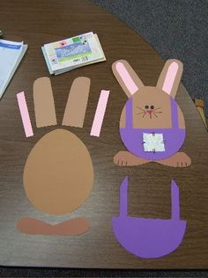 """Here are some more photos of the papers/shapes my Stars used to make their construction paper """"egg"""" bunnies:    I traced around an egg-shape..."""