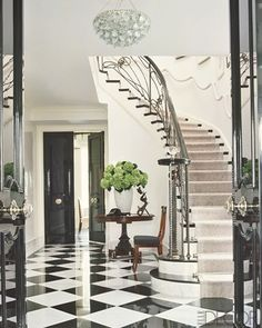 foyer harlequin floor black lacquer door iron staircase