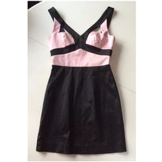 """Bebe cage dress black pink cut out mini xs This is an absolutely stunning dress by Bebe. It is black with rosey pink color blocking. The front has cut outs at the bust and the back is caged and has a full zipper. It is a size xs and has a satin sheen and feel. 57% cotton, 41% polyester, 2% spandex. dry clean.  Arm pit to arm pit: 15.5""""-16.5"""" Waist: 11.5""""-12.5"""" Hips: 16""""-18"""" Arm pit to hem: 22"""" bebe Dresses Mini"""