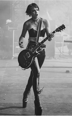 Lzzy Hale, to me she is the-most talented female singer of this era. Female Guitarist, Female Singers, Cherie Currie, Bass, Lzzy Hale, Black High Boots, Women Of Rock, Guitar Girl, Halestorm