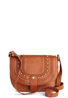Folk Rocker Bag. While touring your vocal stylings, you'll be happy to have this brown shoulder bag as part of your opening act. #tan #modcloth