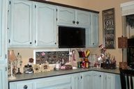 Fantastic DIY craft room makeover! She used old kitchen caninets and refinished them.