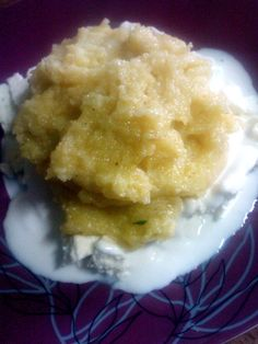 Tradditional romanian food = polenta with cheese and sour cream.  Mamaliga