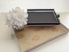 Easy acrylic trays using picture frames, decorative knobs and scrapbook paper. By ConfettiStyle