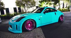 OMG teal 350 with pink rims ; lol is it terrible that I love this xD Nissan 350z, Sexy Cars, Hot Cars, My Dream Car, Dream Cars, Pink Rims, Pretty Cars, Weird Cars, Crazy Cars