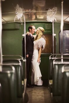 A vintage bus to take this bride and groom to their wedding reception