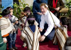 Pin for Later: 23 Times Prince Harry Was Out-of-Control Cute With Kids When He Engaged in a Spot of Play-Fighting in Chile