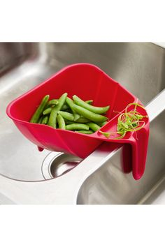 Food colander that hooks over the middle of your sink. Useful!