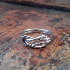 A Hercules knot ring  The story is that Hercules Knot used as a wedding symbol that stands for undying love and commitment. Handmade silver 925 ring from my collection 'Navy knots and cords'.