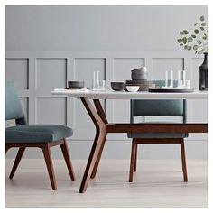 A timeless, modern dining scene that will stun you, not your bank account. Start with a hardwood table paired with armless upholstered chairs. Add an assortment of glass and ceramic tableware, and finish with a marbled vase and flowers. Mid Century Dining Table, Modern Dining Chairs, Dining Furniture, Dining Room Table, Kitchen Dining, Modern Furniture, Apartment Furniture, Outdoor Dining, Furniture Ideas