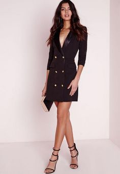 Look fierce this season in this Black blazer dress. In a figure flattering fabric this black number with long sleeves, pocket front, silk collar and gold button feature is seriously chic. Team with black strappy heels and matching clutch fo...
