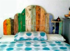The bed headboard created is not only impressive because of the cutting of the pallets to make this design, but the use of paints. This idea is perfect for the kid's room and the sober colors can be used for sophisticated look if someone wants to copy this idea for an adult's room.