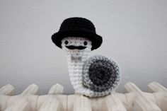 This cute crochet snail has stolen my heart with his tiny mustache and top hat.