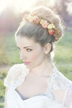 Stunning flower crown updo wedding hairstyle; Featured Photographer: Cecelina Photography