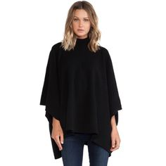 Theory florencia wool poncho sz P/S black Brand new- worn once! Theory florencia wool blend poncho in black. Super soft and cozy, 3/4 length sleeves. Fits anywhere from a size 0 to a size 8 id say. Gorgeous!! Retails for $435 Theory Sweaters Shrugs & Ponchos
