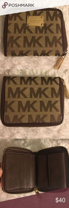 Michael Kors wallet Cute little wallet. It's light and dark brown. Brand new, used twice. A few scratches on metal Michael Kors Bags Wallets