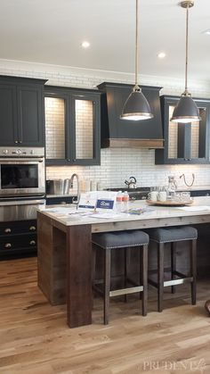So much of this amazing kitchen from the Tulsa Parade of Homes could be DIYed! That wall of tile and the reclaimed wood island are the perfect blend of modern of rustic. I want to live in this house! Home Decor Kitchen, Rustic Kitchen, Kitchen Furniture, New Kitchen, Kitchen Island, Kitchen Ideas, Craftsman Kitchen, Backsplash With Dark Cabinets, Wood Cabinets