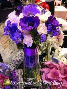 purple anemone and ivory roses  Flowergirls Weddings 58th & Lewis Tulsa, Ok 918-949-1553 www.flowergirlsoftulsa.com