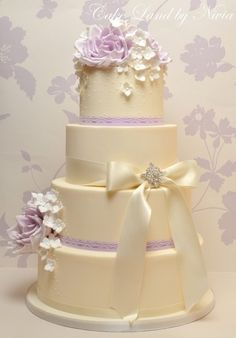 white wedding cake with lavender accents
