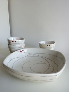 Hand drawn swirly lines and red dots - love this simple design.