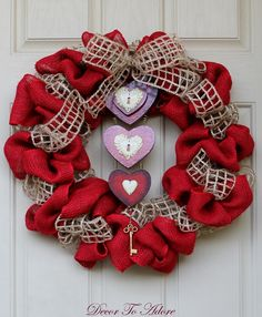 DIY Gorgeous Valentine Wreath Tutorial...link to tutorial, I love the wooden hearts in the center! @Jennifer McFarland.. can u make this lol