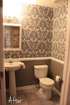 small downstairs bathroom - like the wallpaper and chair rail idea mostly gray with a bit of pink