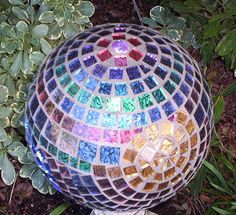 Garden gazing ball.  This was my Christmas present for my parents.  The van gogh tile sparkles beautifully in the sunlight. The mirror tiles reflect colors and add a magical sparkle throughout their yard.  A lovely addition for their garden.  The substrate is an old bowling ball.