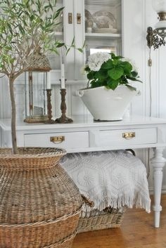 like all the textures--rattan, ceramics, and plants