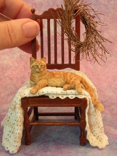 Sleeping ginger tomcat on a chair in dolls house scale by Kerri Pajutee - Photo Courtesy Kerri Pajutee Copyright 2009. Used With Permission